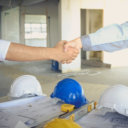 Engineer and businessman handshake agreement in negotiations in Business conference finish.
