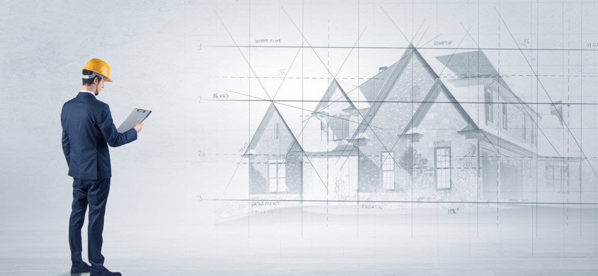 Architect standing with house plan